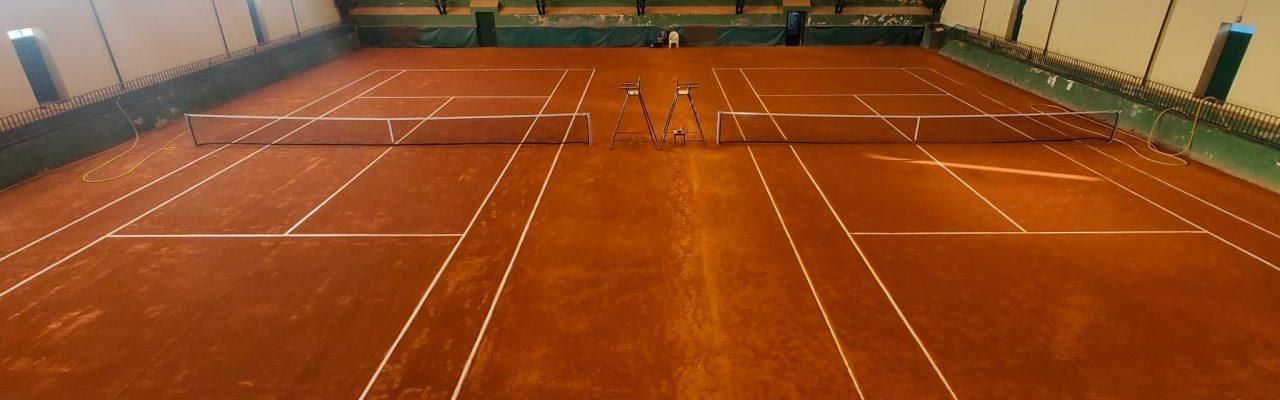 Reparación 2 pistas de tierra batida indoor en Vitoria